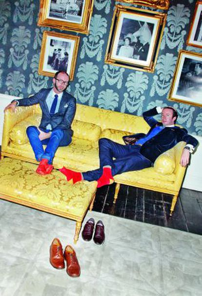 Twins Austin and Howard Mutti-Mewse give a dandyism lesson in the salon of Hardy Amies tailoring, London.