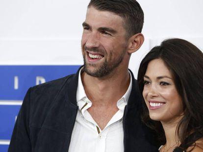 Michael Phelps y Nicole Johnson, en un 'photocall' el pasado mes de agosto.