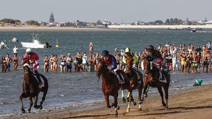 Sanlucar de Barrameda (Cadiz). Carreras de caballos en la playa.