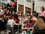 People sit at the terrace of a bar, amid the coronavirus disease (COVID-19) pandemic, in Madrid, Spain, March 28, 2021. REUTERS/Javier Barbancho