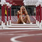 TOPSHOT - Hungary's Luca Kozak reacts after falling in the women's 100m hurdles semi-finals during the Tokyo 2020 Olympic Games at the Olympic Stadium in Tokyo on August 1, 2021. (Photo by Jewel SAMAD / AFP)
