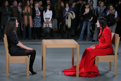Abramovic, in red, during his 'performance' last year at MoMA.