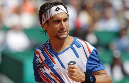 Ferrer celebra un punto ante Nadal.
