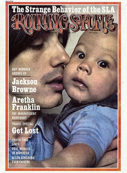Cover of 'Rolling Stone' from May 1974 where he poses with his son Ethan.  The photo is by Annie Leibovitz.