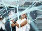 Tennis - WTA 1000 - Madrid Open - Caja Magica, Madrid, Spain - May 8, 2021 Belarus' Aryna Sabalenka celebrates winning her final match against Australia's Ashleigh Barty with the trophy REUTERS/Sergio Perez