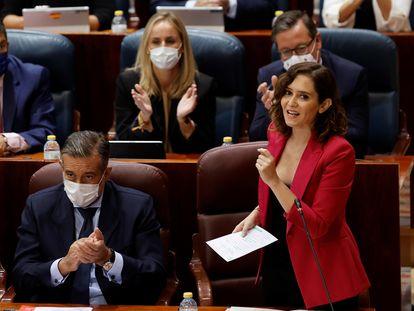 La presidenta de la Comunidad de Madrid, Isabel Díaz Ayuso, interviene en el pleno de la Asamblea, este jueves.