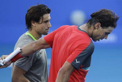 Ferrer y Nadal abandonan la cancha tras el partido.