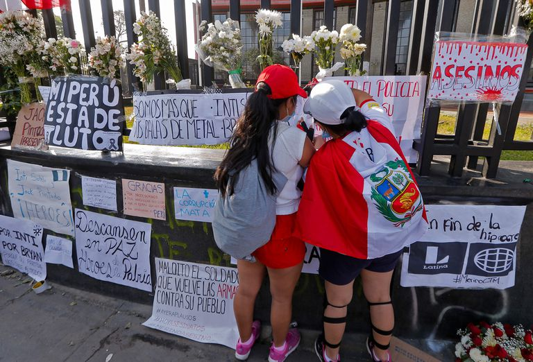 A pair of women in a tribute to the mortal victims during the protests in Lima, Peru.