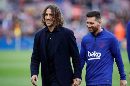 Puyol y Messi, poco antes de un partido entre el Barça y el Alavés en diciembre de 2019.