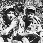 Raul Castro, left, younger brother of Cuban rebel leader Fidel Castro, smokes a pipe with his chief lieutenant, Ernesto Guevara of Argentina shown in their Sierra Cristal mountain stonghold in eastern Cuba, April 1958. (AP Photo/Andrew St. George)