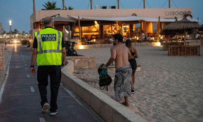 A police officer does control work on a beach in Palma.