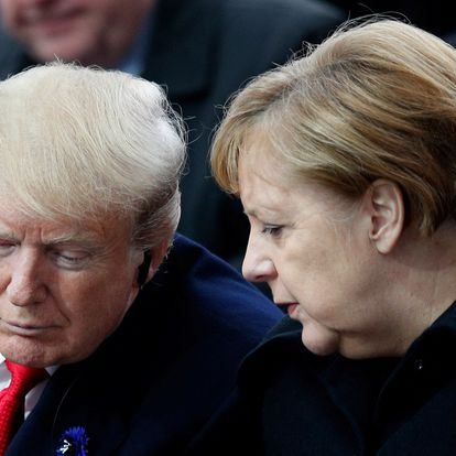 (FILES) In this file photo taken on November 11, 2018 then US President Donald Trump (L) and German Chancellor Angela Merkel (R) speak as they attend a ceremony at the Arc de Triomphe in Paris as part of commemorations marking the 100th anniversary of the 11 November 1918 armistice, ending World War I. - Germany heads into an election on September 26, 2021, the most suspenseful vote in a generation in Europe's biggest economy that will see Chancellor Angela Merkel step down after 16 years in power. (Photo by Francois Mori / POOL / AFP)