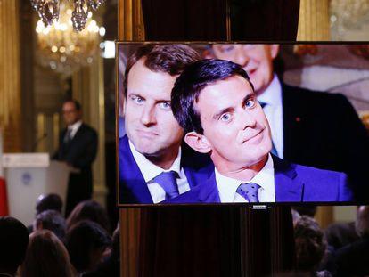 Emmanuel Macron (izquierda) y Manuel Valls (centro), en una rueda de prensa en París (2014).