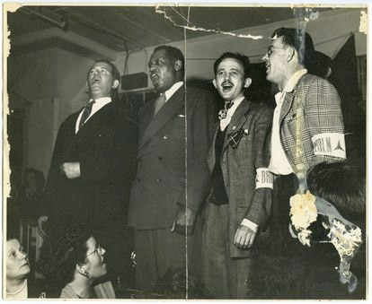 Bart van der Schelling, Paul Robeson, Moe Fishman and Art Landis sing for the international brigades at a concert in Spain (1938).