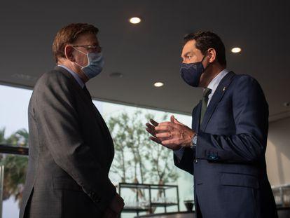 Los presidentes valenciano, Ximo Puig, y andaluz, Juan Manuel Moreno, en Barcelona el pasado junio.