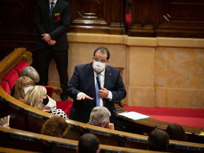 El conseller de Interior de la Generalitat, Joan Ignasi Elena, en un momento de su intervención en el Parlament. / DAVID ZORRAKINO (Europa Press).