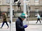 A man looks at his phone in Dublin as the spread of the coronavirus disease (COVID-19) continues, Dublin, Ireland, March 31, 2020. REUTERS/Jason Cairnduff