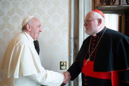 Cardinal Reinhard Marx (right) greets Pope Francis in a private audience at the Vatican in February 2020.