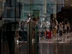 People arrive at Barcelona airport, Spain, Monday, June 7, 2021. Spain is trying to ramp up its tourism industry by welcoming from Monday vaccinated visitors from most countries, as well as all Europeans who prove that they are not infected with the coronavirus. (AP Photo/Emilio Morenatti)