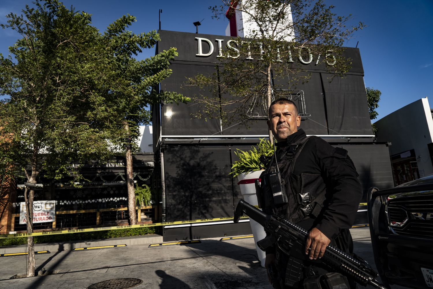 Elements of the Jalisco state police guard the District 5 Bar.
