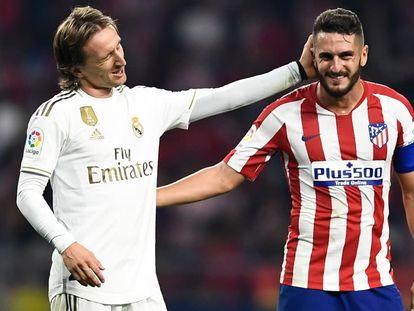 Modric y Koke, durante el derbi de la temporada pasada celebrado en el Wanda Metropolitano. / (EFE)