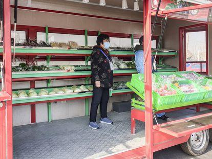 Un puesto temporal de venta de verduras en Heizhuanghu (China).