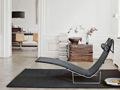 Lounge Chair de PK 24 ™ de Poul Kjærholm fabricada por Fritz Hansen valorada en 13.141 euros.