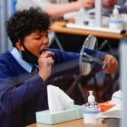 A student takes a lateral flow test at Weaverham High School, as the coronavirus disease (COVID-19) lockdown begins to ease, in Cheshire, Britain, March 9, 2021. REUTERS/Jason Cairnduff