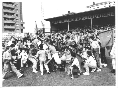 SD Eibar fans surround the club's players on the Ipurua stadium lawn in a file image.