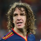 Carles Puyol of Spain and Referee Howard Webb (Photo by AMA/Corbis via Getty Images)
