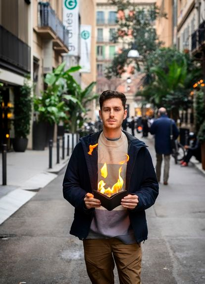 David Riudor practices one of his favorite tricks on a Barcelona street, taking fire out of a wallet.