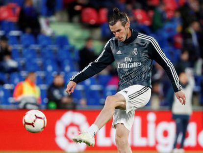 Bale, durante un calentamiento de la temporada anterior.