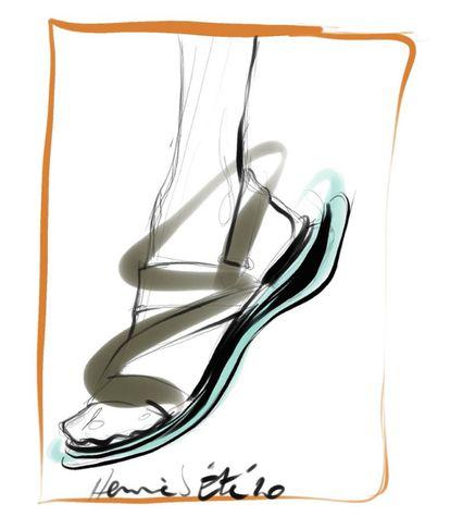 Sandalia con tiras de piel cruzadas y suela en contraste de goma y piel.