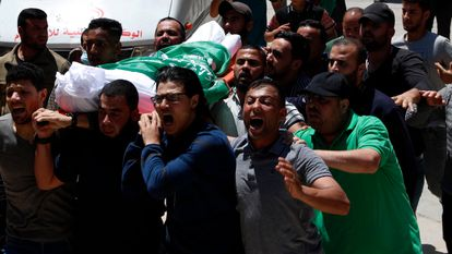 The body of a Hamas militant is transported by a group of men on May 13.