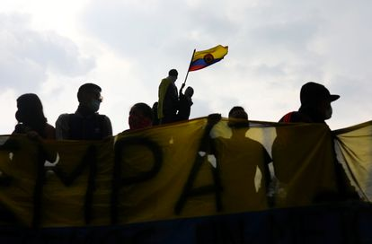 Protesters wave a flag during a protest against the tax reform of President Ivan Duque's government in Bogota, Colombia, May 1, 2021. REUTERS/Luisa Gonzalez