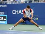 Carlos Alcaraz, of Spain, returns a serve against Peter Gojowczyk, of Germany, during the fourth round of the U.S. Open tennis championships, Sunday, Sept. 5, 2021, in New York. (AP Photo/Frank Franklin II)