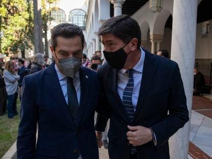 El presidente de la Junta de Andalucía, Juan Manuel Moreno (PP), y el vicepresidente, Juan Marín (Cs), tras su rueda de prensa conjunta de este miércoles en Sevilla.
