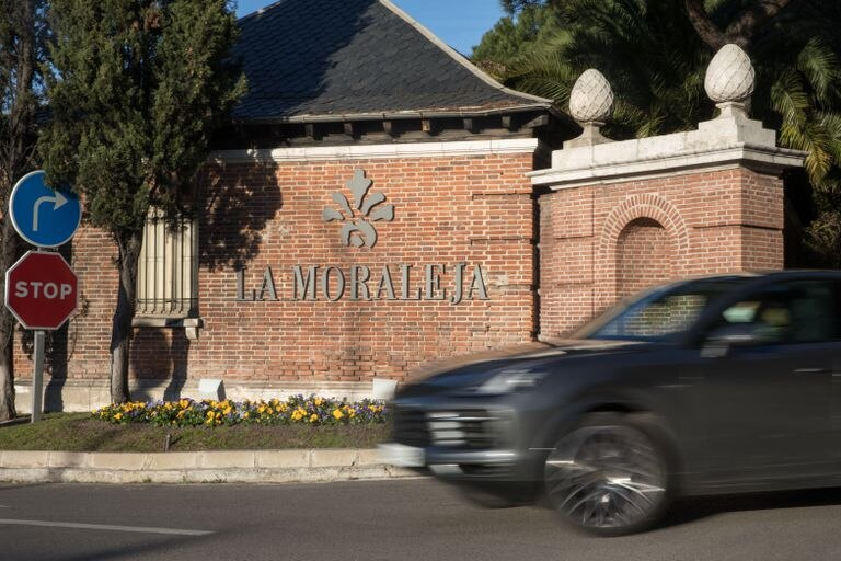 Un coche sale de La Moraleja, este viernes.