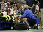 NEW YORK, NEW YORK - SEPTEMBER 07: Carlos Alcaraz of Spain talks with a trainer during his Men�s Singles quarterfinals match against Felix Auger-Aliassime of Canada during on Day Nine of the 2021 US Open at the USTA Billie Jean King National Tennis Center on September 07, 2021 in the Flushing neighborhood of the Queens borough of New York City.   Sarah Stier/Getty Images/AFP == FOR NEWSPAPERS, INTERNET, TELCOS & TELEVISION USE ONLY ==