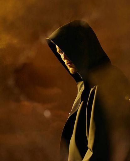 Not all heroes wear a cape.  Ed Skrein wears a hood, that of this grim reaper CH Carolina Herrera.