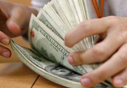 El Cedin será canjeable por dólares en efectivo en el banco para efectuar inversiones inmobiliarias. EFE/Archivo