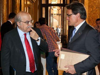 El consejero de Economía, Andreu Mas-Colell, junto al presidente de la Generalitat, Artur Mas, en 2013.