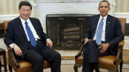 El entonces vicepresidente chino, Xi Jinping, y el estadounidense, Barack Obama, en una reunión en 2012.