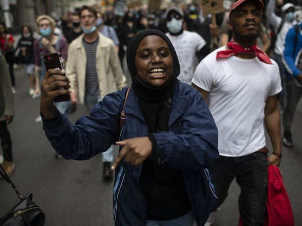 Protesters chant and march through the streets of Manhattan during a solidarity rally calling for justice over the death of George Floyd Tuesday, June 2, 2020, in New York. Floyd died after being restrained by Minneapolis police officers on May 25. (AP Photo/Wong Maye-E)