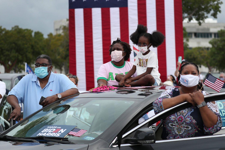 Una familia, en el mitin de Obama en Miami.