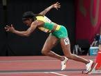 Elaine Thompson-Herah, of Jamaica, starts a women's 200-meter semifinal at the 2020 Summer Olympics, Monday, Aug. 2, 2021, in Tokyo. (AP Photo/Matthias Schrader)