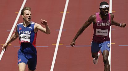 Rai Benjamin is second to Karsten Warholm, who set a new world record in the final of the 400m hurdles.