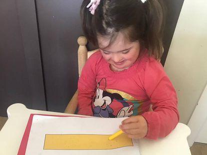 La hija de Terry de cinco años y con síndrome de Down.
