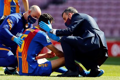 Busquets is treated in the field after the fortuitous blow with Savic.