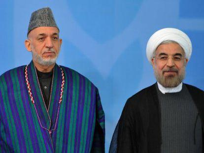 Hamid Karzai, presidente de Afganistán (izquierda) y el presidente de Irán, Hasan Rouhaní.